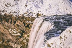 Water Falls Beside Mountains With Snow Stock Photography