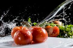 Free Water Falls On Red Tomatoes Royalty Free Stock Photography - 216365837