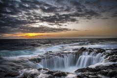 Water Falls Overlooking Sunset Under Grey and Brown Sky during Twilight Stock Photography