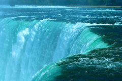 Water falls rises over the edge of the Horseshoe Falls at Niagara. Brim of the Horseshoe Falls at Niagara Stock Images