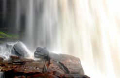 Water falls on rocks Stock Photography