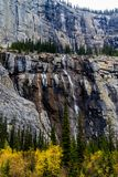 Weeping wall, Banff National Park, Alberta, Canada. Water falls from the weeping wall in late fall in banff Stock Photo