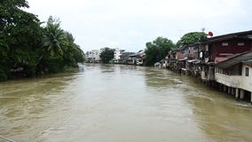 Water fast and severe in chanthaburi rive in Chanthaburi, Thailand. Water fast and severe in chanthaburi river because flash flood after rainy at Old Town stock video footage