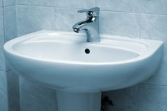 Water faucet and basin Stock Photo
