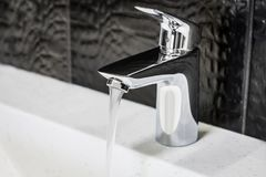 Water faucet in the bathroom or toilet Stock Photo