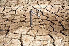 Water Faucet on Dry Soil Texture Stock Images