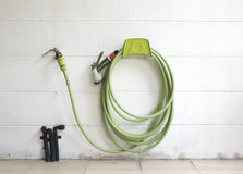 Water faucet and green garden hose Royalty Free Stock Photography