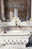 Water faucet on historical clock tower in Izmir Royalty Free Stock Photography