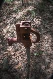 A water faucet standing alone in the forest park. royalty free stock photography