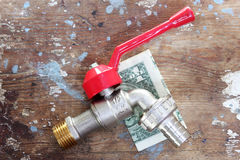 Water faucet or tap with money Royalty Free Stock Image