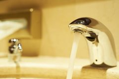 Water faucet and towel dispenser Stock Image