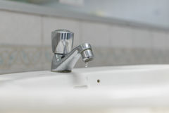 Water faucet with washbasin in bathroom Royalty Free Stock Images