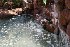Water feature. A outside water feature with two small water falls stock photography