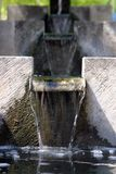 Water feature. Stepped water feature, water flowing in small waterfalls towards us Stock Photo