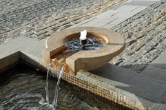 Water feature. A stone water feature pouring into a trough royalty free stock images