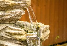 Water Feature. A close up view of a garden water feature cascading down stock photography