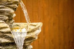 Water Feature. A close up view of a garden water feature cascading down royalty free stock photo