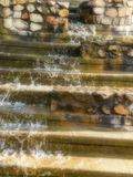 Water feature. A close-up view of a waterfall water feature Stock Photography