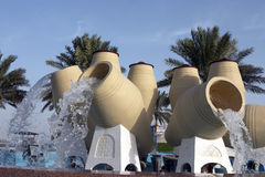 Water feature, Doha. Water pot feature on Doha's Corniche. The pots are supported on plinths reminiscent of incense burners, both symbolise welcome in Arab Royalty Free Stock Images