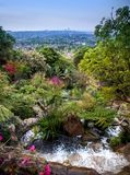 Water feature flowing into lush garden stock photos