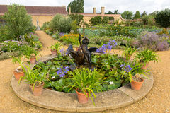 Water feature and gardens Barrington Court near Ilminster Somerset England uk with gardens in summer sunshine Royalty Free Stock Photos