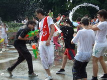 Water fight. Summer water fight in Herastrau park, Bucharest royalty free stock image