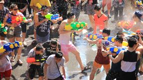 Water Fight. Combat With Water For Fun. Battle shooting with water guns. Tourist happy with splash water on songkran day or thai new year  celebrated  local Stock Images