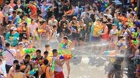 Water Fight.Shooting With Water For Fun. Battle for fun. Tourist happy with splash water on songkran day or thai new year  celebrated  local traditional festival Stock Image