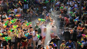 Water Fight Or Songkran Festival. Combat For Fun. Battle for fun. Tourist happy with splash water on songkran day or thai new year celebrated local traditional royalty free stock images