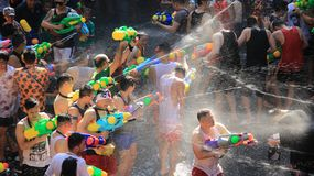 Water Fight  Or Songkran  Festival. Shooting with fun.Tourist happy with splash water on songkran day or thai new year  celebrated  local traditional festival in Royalty Free Stock Photo
