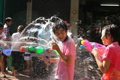Bangkok, Thailand - April 15: Water fight in Songkran Festival Thai New Year on April 15, 2011 in soi Kraisi, Bangkok, Thailand. Water fight in Songkran Royalty Free Stock Image