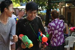 Bangkok, Thailand - April 15: Water fight in Songkran Festival Thai New Year on April 15, 2011 in soi Kraisi, Bangkok, Thailand. Water fight in Songkran Stock Photos
