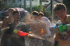 Bangkok, Thailand - April 15: Water fight in Songkran Festival Thai New Year on April 15, 2011 in soi Kraisi, Bangkok, Thailand. Water fight in Songkran Royalty Free Stock Photos