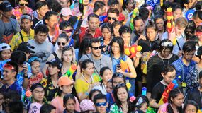 Water Fight  Or Songkran  Festival.Visitors Join With Fun. Visitors come with plastic water guns.Tourist happy with splash water on songkran day or thai new year Stock Photo