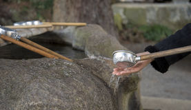 Water-filled basins, called chozubachi, are used by worshipers for washing their hands. Water-filled basins, called chozubachi, are used by worshipers for Royalty Free Stock Images