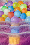 Water filled colored balloons. Multicolored water filled colored balloons laying on  a moistened airbed Royalty Free Stock Image