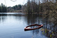 Water filled rowboat Royalty Free Stock Photo