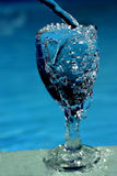 Water filling glass. Water filling wine glass Stock Image