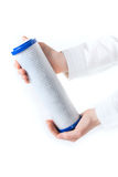Water filter cartridge in human hand. Isolated on white Stock Photos