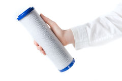 Water filter cartridge in human hand. Isolated on white Stock Photography
