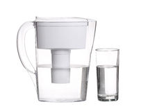 Water filter jug with glass of clean water isolated on white Royalty Free Stock Photo