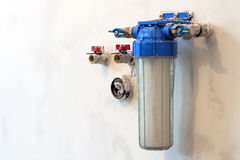 Water filter new installed on a kitchen wall to purify drinking. Water Stock Photo