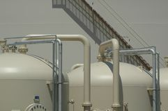 Water Filtration Plant. Water Filters in forground, and Resevoir in background Stock Photography