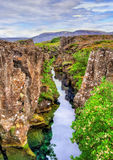 Water in a fissure between tectonic plates in the Thingvellir National Park, Iceland Royalty Free Stock Photos