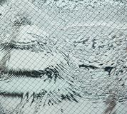 Water pattern behind glass panel royalty free stock photo