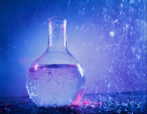 Water in flask. Glass flask with clear water royalty free stock photo