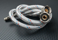 Water flexible hose in metallic braiding Royalty Free Stock Image