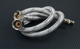 Water flexible hose in metallic braiding Royalty Free Stock Photography