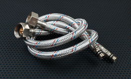 Water flexible hose in metallic braiding Royalty Free Stock Images
