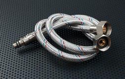 Water flexible hose in metallic braiding stock photography